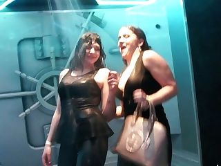 Two Promiscuous Chicks Perceive Up Each Other And Dance Under The Bathroom In One Night Club