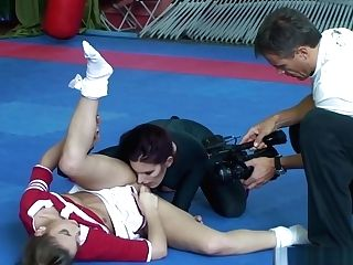 Sapphic Cheerleader Grappling On The Floor
